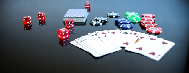 Playing cards, poker chips, and dice