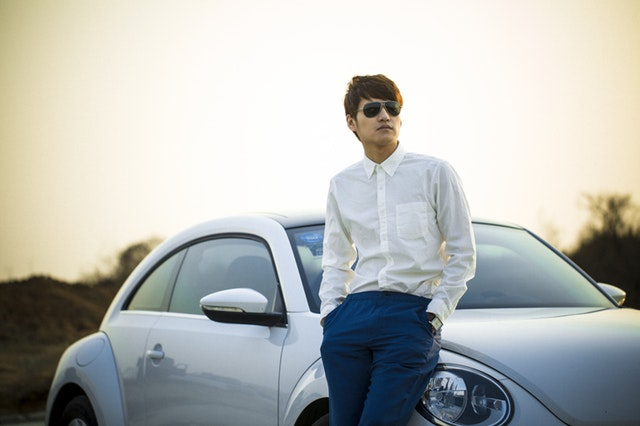 Young man with nice car